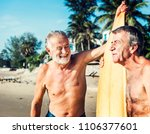 surfers at a nice beach | Shutterstock . vector #1106377601