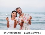 couple celebrating with...   Shutterstock . vector #1106389967