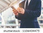 businessman holding smartphone. ... | Shutterstock . vector #1106434475