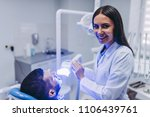 smiling doctor looking at the... | Shutterstock . vector #1106439761
