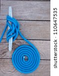 Blue Rope Coiled On A Wooden...