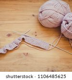 knitting needles and yarn on... | Shutterstock . vector #1106485625