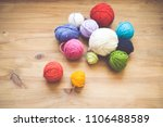 colorful yarn balls  on wooden... | Shutterstock . vector #1106488589