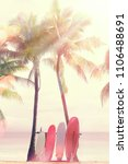 surfboard and palm tree on... | Shutterstock . vector #1106488691