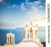 Small photo of white church belfries against volcano caldera, beautiful details of famous Santorini island, Greece, toned