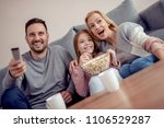 young family watching tv... | Shutterstock . vector #1106529287