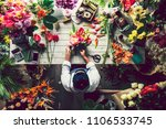 florist making a flower... | Shutterstock . vector #1106533745
