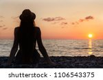 girl in the hat sitting on the... | Shutterstock . vector #1106543375