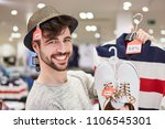 Happy Young Man Shopping By...
