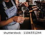barista making cafe latte in... | Shutterstock . vector #1106551244