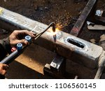 metal work. man cuts a hole in... | Shutterstock . vector #1106560145