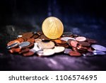 golden eos.io and mound of...   Shutterstock . vector #1106574695