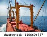 cargo ship sailing in high sea | Shutterstock . vector #1106606957