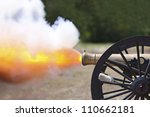 Civil War cannon firing at a civil war re-enactment.