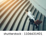 businessman holding suitcase... | Shutterstock . vector #1106631401