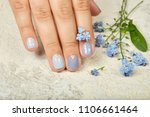 hand with short manicured nails ... | Shutterstock . vector #1106661464
