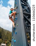 young woman climbing and... | Shutterstock . vector #110666225