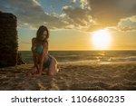supermodel posing at sunset on... | Shutterstock . vector #1106680235