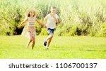 two happy cheerful children in... | Shutterstock . vector #1106700137