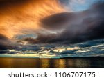 sunset over stormy clouds... | Shutterstock . vector #1106707175