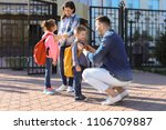 young parents saying goodbye to ... | Shutterstock . vector #1106709887