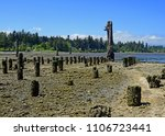 Tall Wooden Pillars Remnants O...