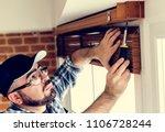 people installing window curtain | Shutterstock . vector #1106728244