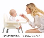 mom feeds the baby in a baby... | Shutterstock . vector #1106732714