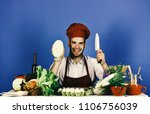 cook with happy face on blue... | Shutterstock . vector #1106756039