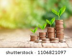 tree growing on coins stack... | Shutterstock . vector #1106821097
