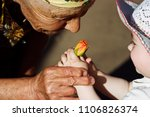 the old grandmother inhales the ... | Shutterstock . vector #1106826374