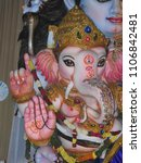 Small photo of Indian God Ganesh Statue, idol. coated with ceramic colors.