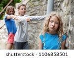 children tease the girl. boy... | Shutterstock . vector #1106858501