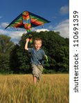 happy boy  with bright kite... | Shutterstock . vector #110691359