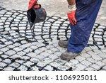 worker using tar bucket and... | Shutterstock . vector #1106925011