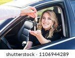 an attractive woman in a car... | Shutterstock . vector #1106944289