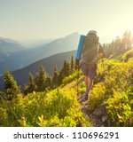 backpacker  in summer mountains - stock photo