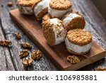 ice cream sandwiches with nuts... | Shutterstock . vector #1106985881