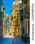 view of a narrow street in the... | Shutterstock . vector #1106989454