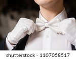 gentleman touch his white tie... | Shutterstock . vector #1107058517