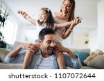 happy family having fun time at ... | Shutterstock . vector #1107072644