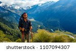 traveler with the view of mount ... | Shutterstock . vector #1107094307