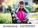 sad schoolgirl sitting in the... | Shutterstock . vector #1107099545