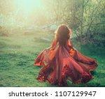 a brunette girl with wavy ... | Shutterstock . vector #1107129947