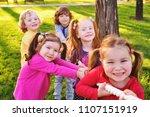 children play tug of war in the ...   Shutterstock . vector #1107151919