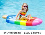 happy child on inflatable ice... | Shutterstock . vector #1107155969