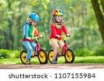 children riding balance bike....   Shutterstock . vector #1107155984