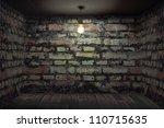 Dark room with brick walls - stock photo