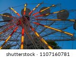 Small photo of Entertainment carousel wheel and blue sky.Festival and amusement concept.