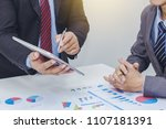 two businessman using tablet.... | Shutterstock . vector #1107181391
